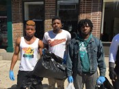 Towson University student Michael Bell (Center) and others help cleanup west Baltimore after Monday night's looting. Photo from the Twitter feed of CNBC reporter Eamon Javers.