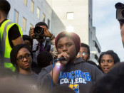 Jordan Johnson, middle, addresses a crowd at a protest in Baltimore. The photo was taken by Goucher College student Ester Grossman