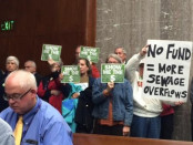 Protesters against phasing out the stormwater management fee attend the Nov. 16 Baltimore County Council meeting.