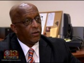City Council President Bernard C. Young talks to WJZ News last April after a violent weekend. Photo from WJZ website.