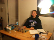 Sam Padham sits in his apartment before graduating from Towson University on Friday. Photo by Ron Miller.