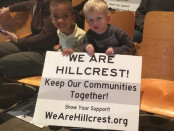 Two students from Hillcrest Elementary join the protest against a redistricting plan that could move them to a new school. Photo by Taylor Haire.