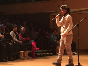 Madea Bailey, who goes by the stage name Da Truth, performing in front of about 150 people at the Reginald F. Lewis Museum in Baltimore. Photo by Faras Aamir.