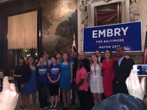 Mayoral candidate Elizabeth Embry with supporters Tuesday night.