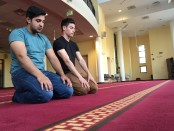 Towson University students, Muzzamil Choudry and Youssef Moustafa, stop by the Islamic Society of Baltimore for evening prayers. Photo by Faras Aamir
