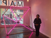 "Artist Mina Cheon stands with her sculpture ""Pink Diamond."" Cheon created the ""Pink Diamond"" as part of a series of aluminum and LED structures in 2007 with her husband Gabriel Kroiz.  Photo by Neil Kenworthy."