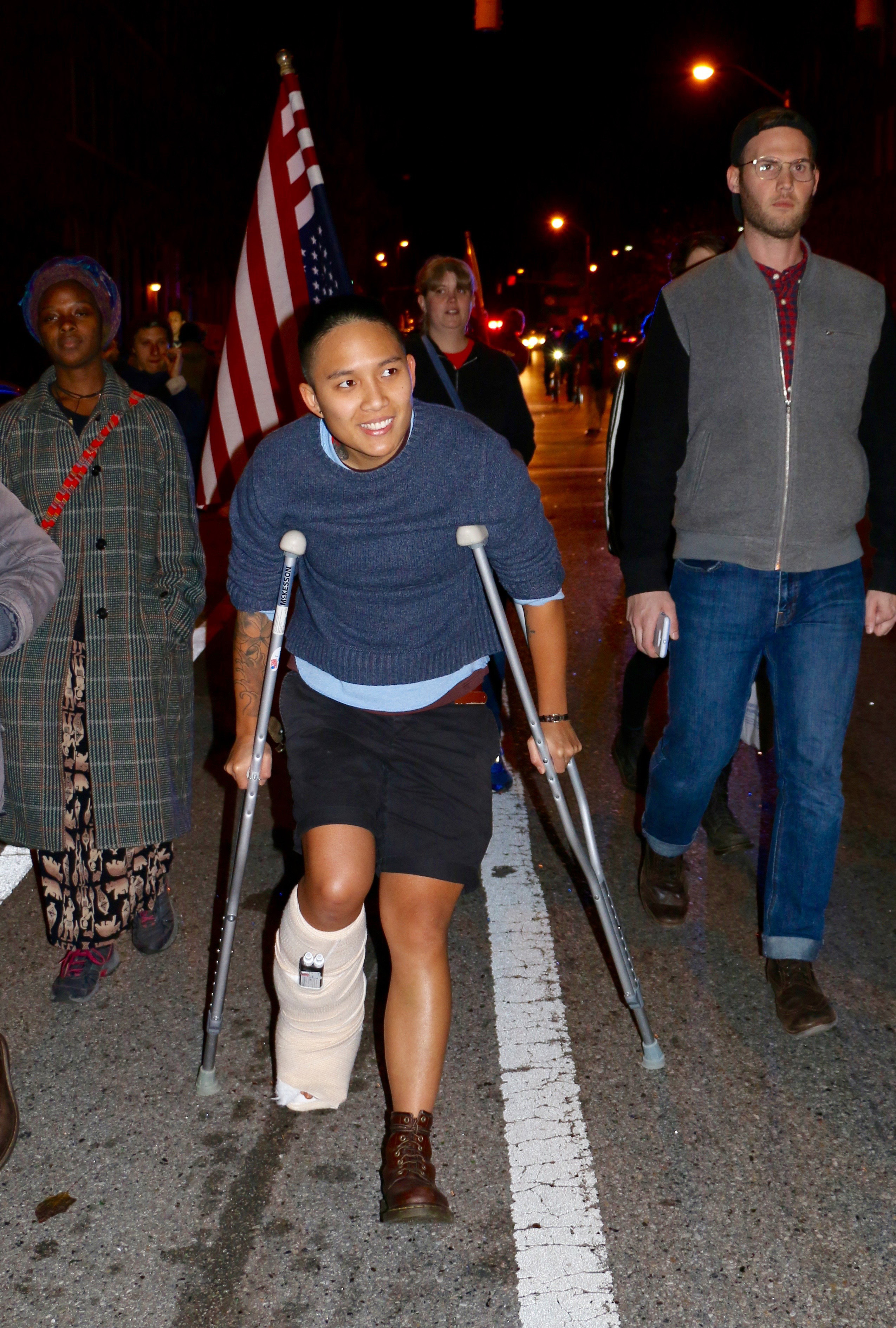 Sam Du, marches on crutches with broken ankle. Photo by Tracy Smith.