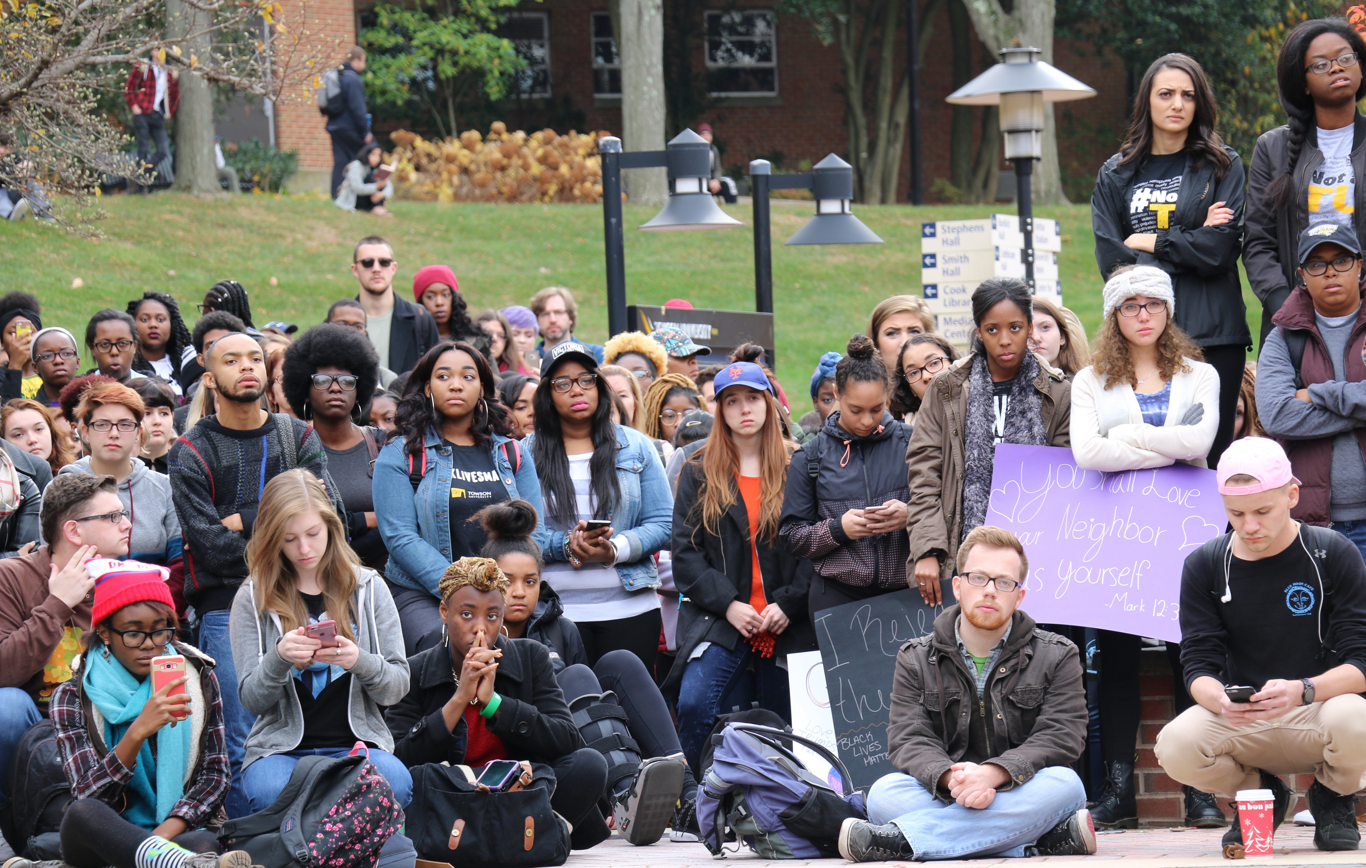 Towson University students listen to speakers at Freedom Square during an anti-Trump walkout Monday. Photo by Tracy Smith.