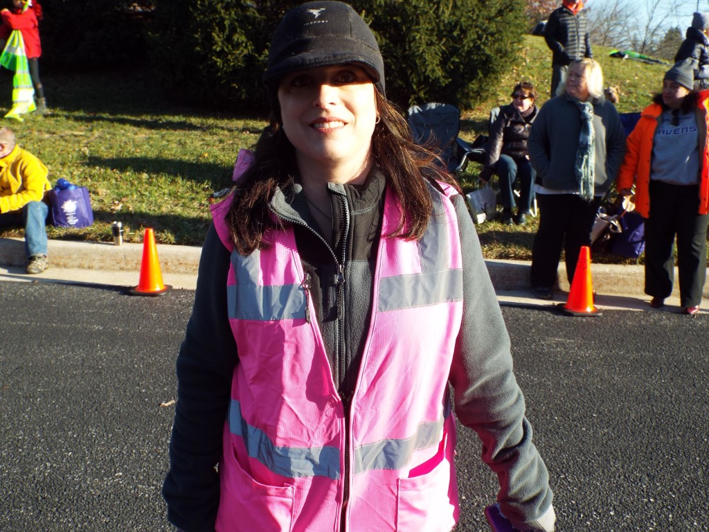 Jessamine Duvall, the executive director of the Girls on the Run Maryland Central council, helps during last weekend's 5K race in Columbia. Photo by Allysa McMahon.