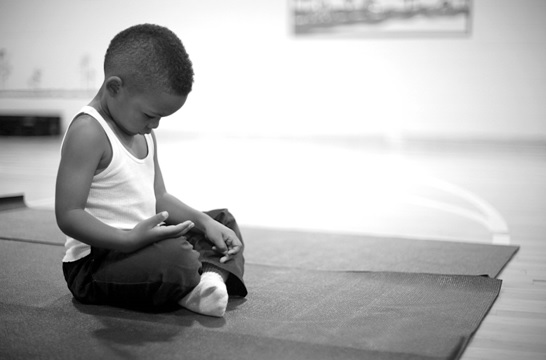 Students practice breathing exercises and yoga as part of the Mindful Moments Program. Photo's courtesy of The Holistic Life Foundation.