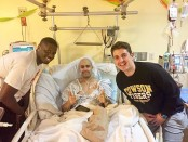 Matt Geisser (middle) with his friends Moe Ndiaye (left) and Aaron Goldenberg (right) after knee surgery to remove the cancer from his leg.