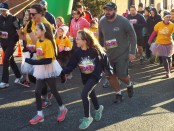 The Hieatzman family begins the 5K Girls on the Run race last weekend in Columbia. Photo by Allysa McMahon.
