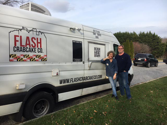 Jeff and Jo Gordon stand by the vehicle they use to sell their famous crab cakes. Photo by Tyler McGee.