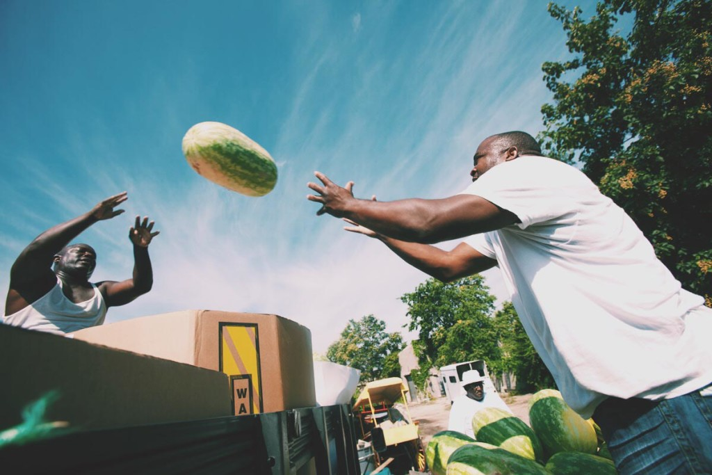 This photograph of two men unloading watermelons is one of Warren's many vivid photographs of Arabbers loading up fresh fruit to be sold to Baltimore locals.