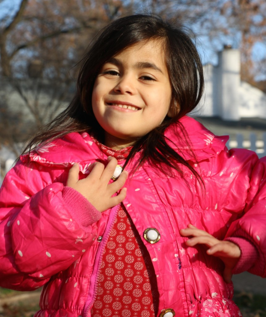 Six-year-old Syrian refugee Ghadir plays outside in her new home in Maryland. She suffers from sickle beta thalassemia, a fatal disease. Photo by Tracy Smith.