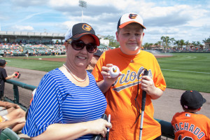 Bonnie Pugh and her teenage son, David Bolling, attend an Orioles' spring training game. Photo by Nick Rynes