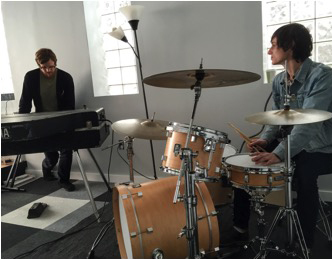 Justin Levy (right) practices on the drums. Photo provided by Levy.