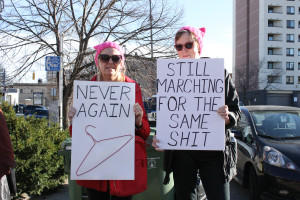Two women with abortion signs