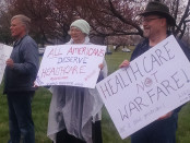 Protesters wait outside in the rain before a town hall meeting with U.S. Rep. Andrew P. Harris, R-Md. Photo by J. K. Schmid.