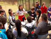 Mercedes Thompson (center with red sweatshirt and grey t-shirt) at the 2nd annual Youth Summit on April 2. Photograph provided by Andrea Calderón.jpg.