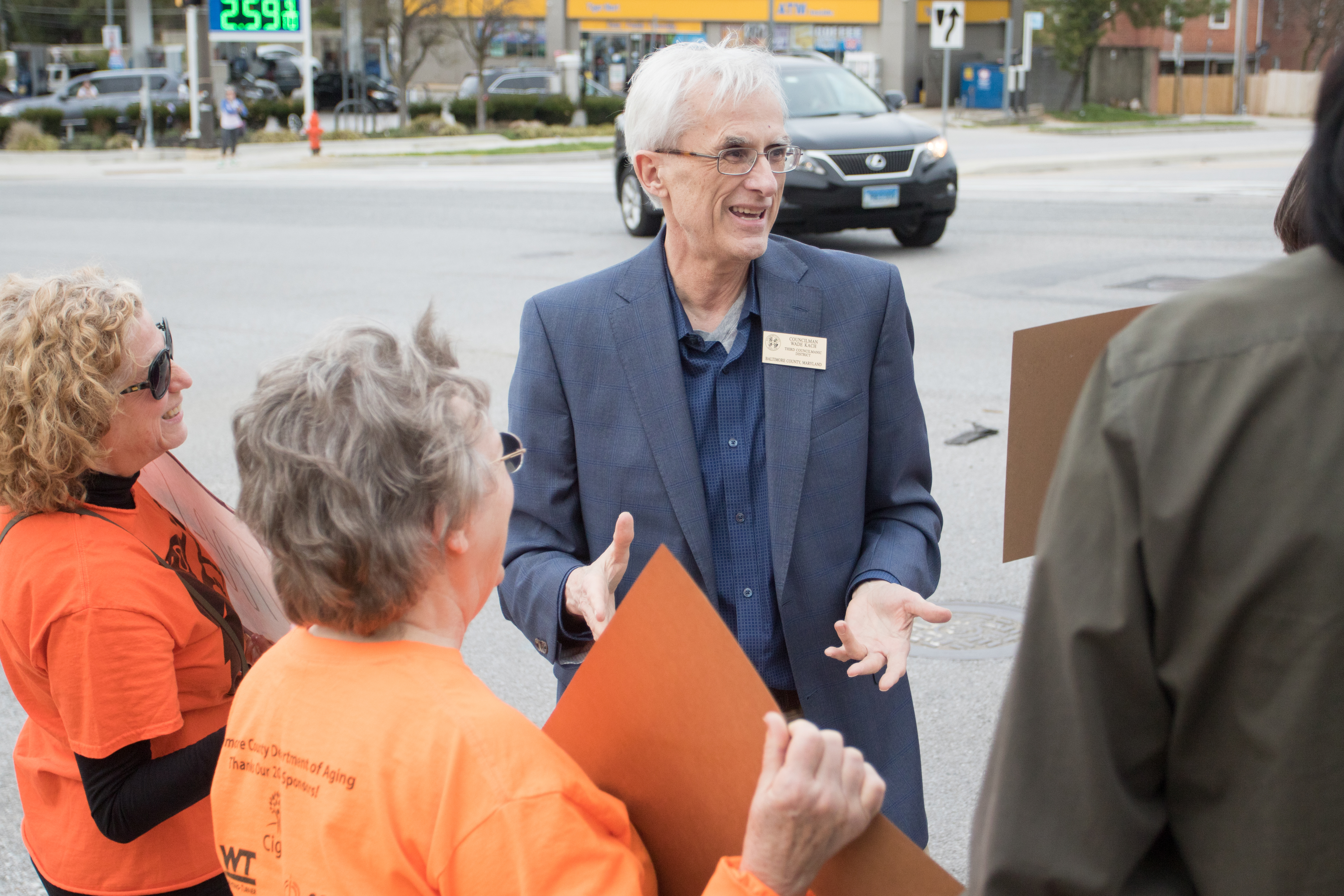Councilman Wade Kach, R-District 3, (center) talks with protesters at York Road and Bosley Avenue on Wednesday. Photo by Nick Rynes.