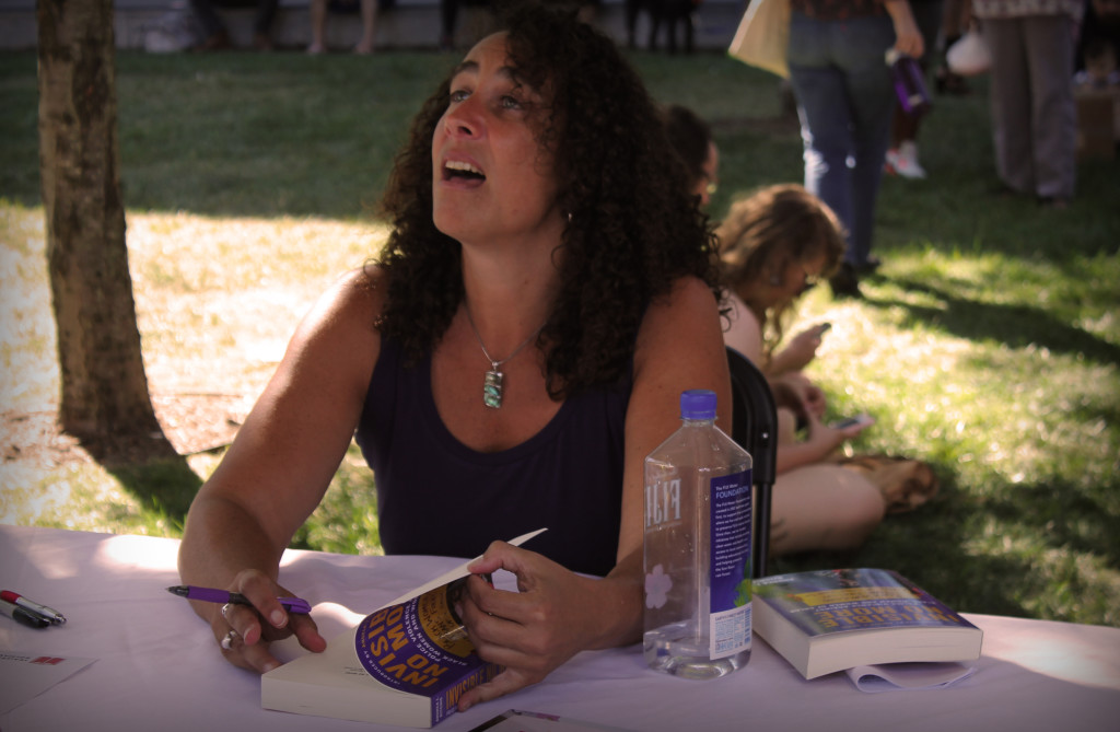Andrea Ritchie signs books after giving a talk about oppression at the Baltimore Book Festival last weekend. Photo by Danielle N. Papilon.