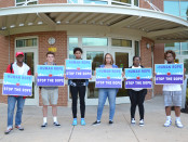 Volunteers at Bel Air High School work to raise awareness about the growing problem of drugs in Harford County during last week's A Human Rope to Stop the Dope event. Photo by Erin Tyszko