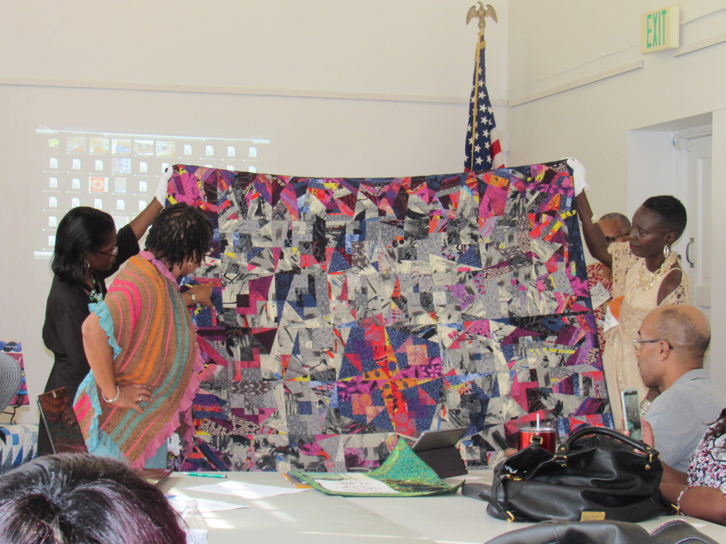 Quilters discuss details of their craft. Photo by Kalia Green