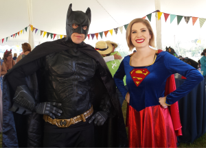 Batman and Supergirl team up to fight cancer. Photo by Taariq Adams 
