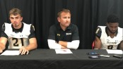 Ryan Stover (left), Rob Ambrose (center) and Monty Fenner (right) talk postgame about Towson's 63-17 loss. Photo by Jordan Cope.