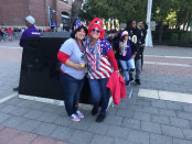 Donna Strobel (left) and Sandy Coho (right) pose in front of Ray Lewis' statute at Ravens stadium Sunday afternoon.  The two ladies had walked out in protest of the players kneeling both here and in London last Sunday. Photo by Sarah Thompson.