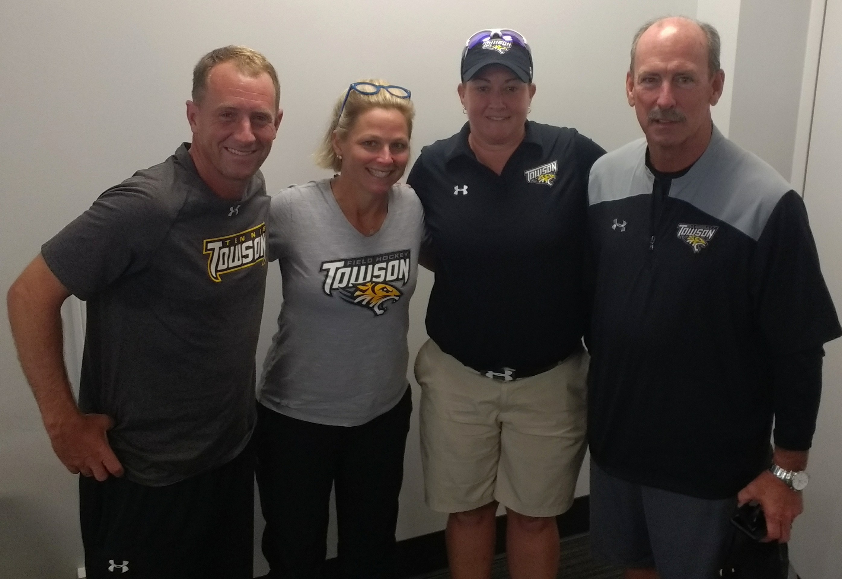 Peterson (left) with fellow first-year coaches at Towson.