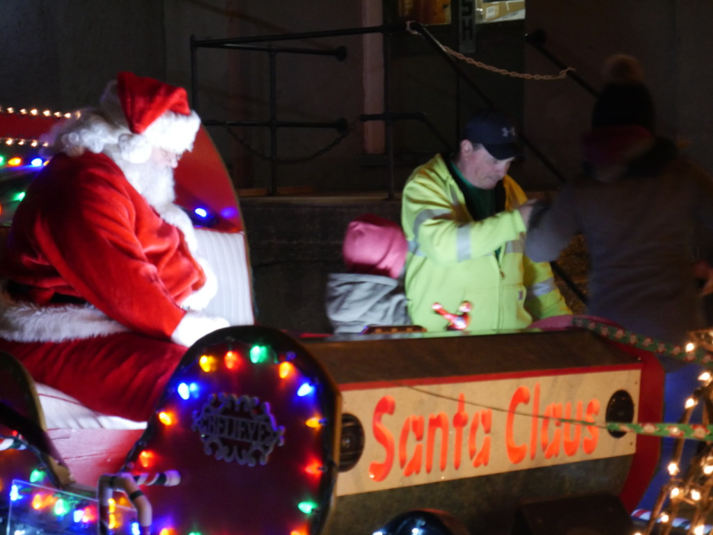 Santa Claus waits on his sleigh to hear what children want for Christmas. Photo by Kyle Armstrong.