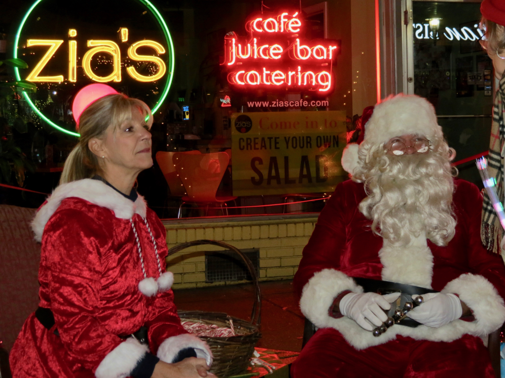 Santa and Mrs. Claus ride fire truck into town to mingle. Photo by Morgan Schmidt.